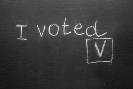 Text I VOTED on dark background