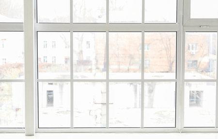 Big modern metal-plastic window in room