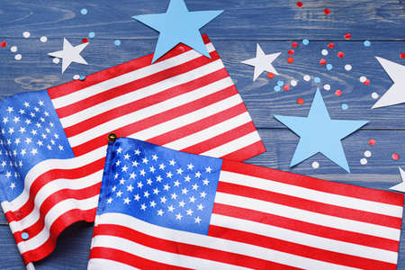 USA flags and stars on wooden background. Memorial day celebration