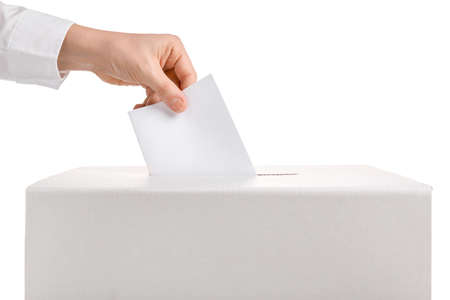 Woman putting ballot paper in voting box against white background