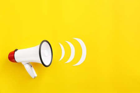 Modern megaphone on color background