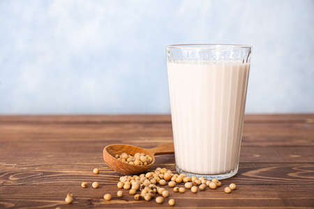 Glass of soy milk on table