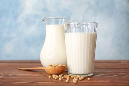 Tasty soy milk on table