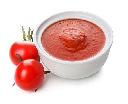 Bowl with tasty tomato sauce on white background