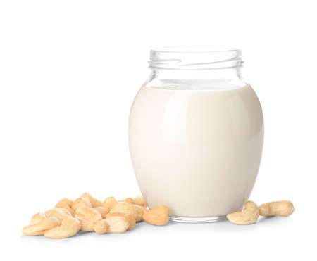Jar of cashew milk with nuts on white background Banque d'images