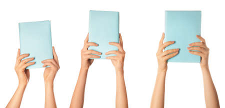 Female hands with books on white background