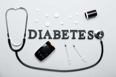 Composition with word DIABETES on light background Stock Photo