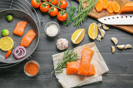 Composition with fresh raw salmon on table Stock Photo