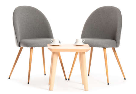 Modern chairs and table on white background