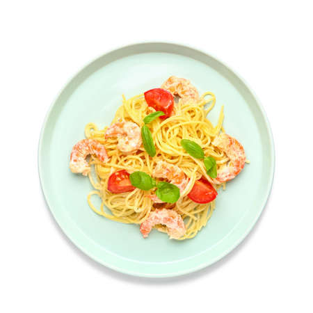 Plate with tasty pasta and shrimps on white background
