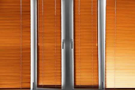 Modern blinds hanging on window Standard-Bild