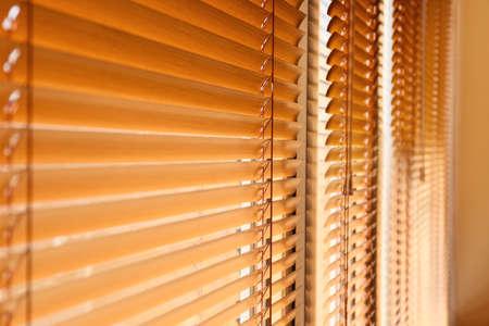 Modern blinds hanging on window