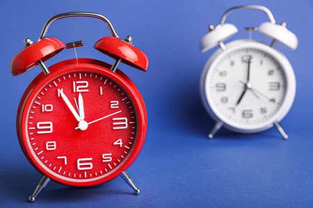 Alarm clocks on color background. Time management concept Standard-Bild