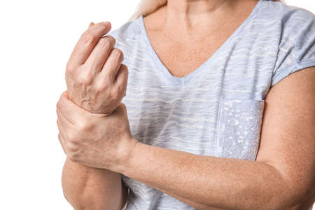 Senior woman suffering from Parkinson syndrome on white background, closeup Stockfoto