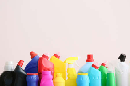 Set of cleaning supplies on light background Imagens