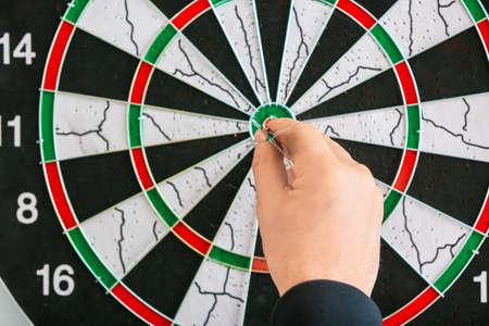 Young man playing darts, closeup