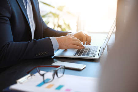 Businessman working on laptop in office Stock fotó