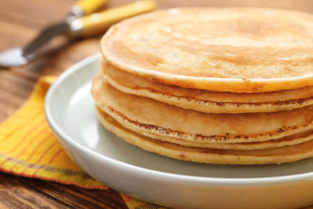 Stack of tasty pancakes on plate