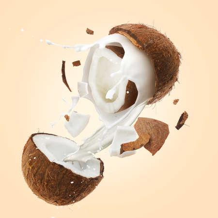 Cracked coconut and milk on color background