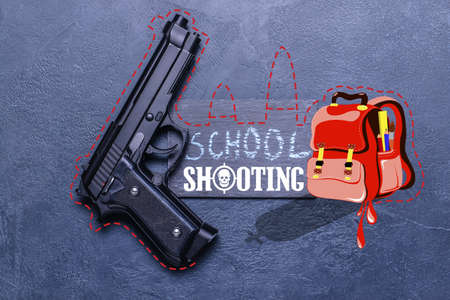 Gun and drawn backpack on gray background. Problem of shooting at school Foto de archivo