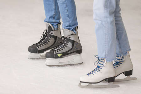 Young couple on skating rink