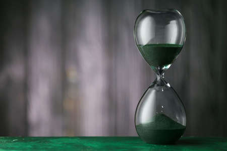 Hourglass on dark background. Time management concept Banque d'images
