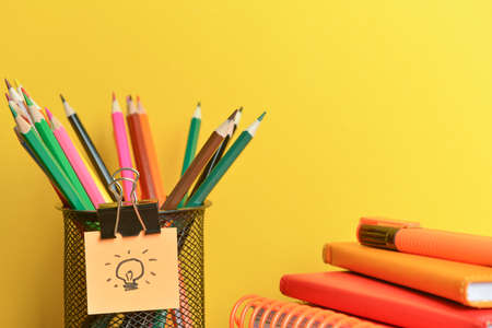 Set of school supplies on color background