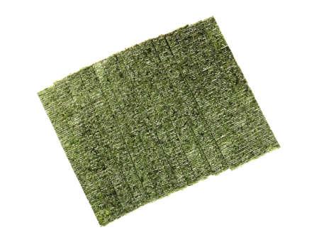 Tasty seaweed sheets on white background