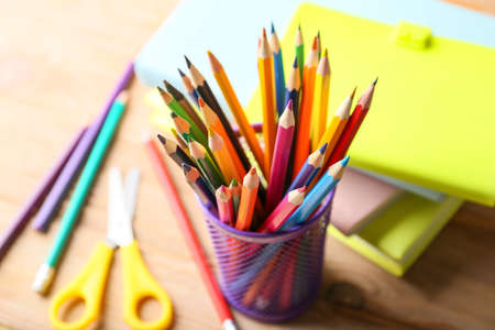 Pencils and school supplies on wooden table Stockfoto