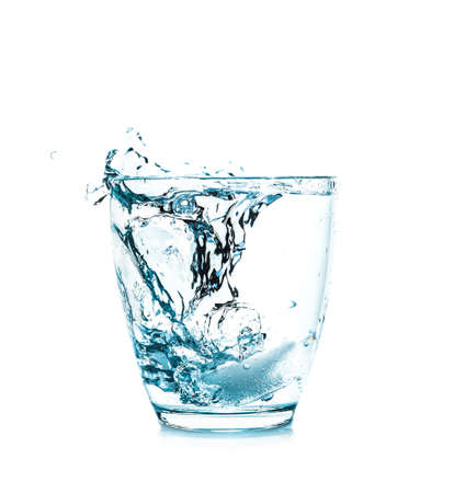 Glass of fresh water with splash on white background