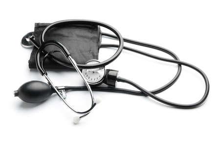 Sphygmomanometer and stethoscope on white background
