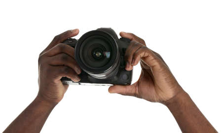 Hands of African-American photographer with camera on white background