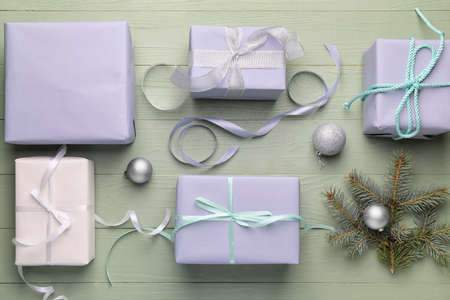 Beautiful gifts for Christmas with decor on color wooden background