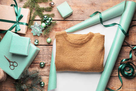 Making of beautiful Christmas gift on wooden background