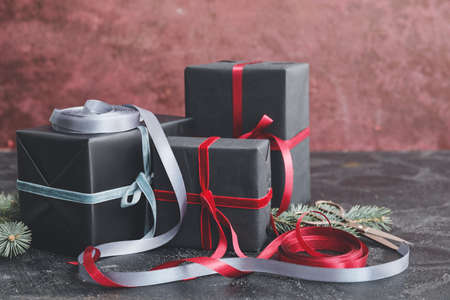 Beautiful gifts for Christmas on color background