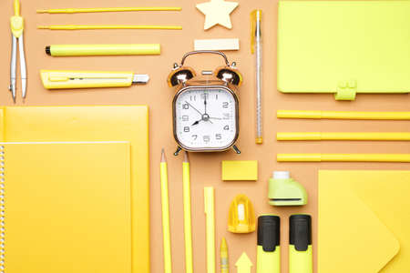 Set of school supplies with clock on color background Standard-Bild