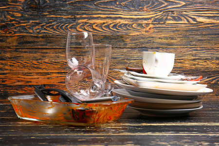 Dirty tableware on wooden background