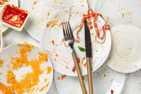 Dirty empty tableware on light background