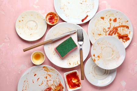 Dirty tableware on color background Standard-Bild