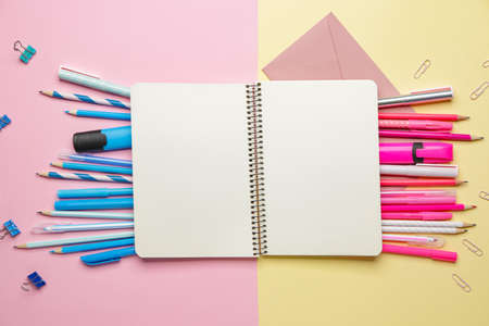 Notebook with school supplies on color background
