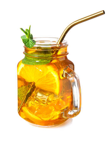 Mason jar of cold tea on white background
