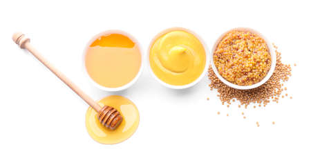 Bowls of honey, mustard and sauce on white background