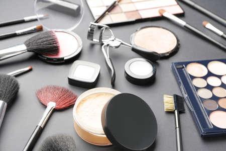 Set of decorative cosmetics on dark background Imagens