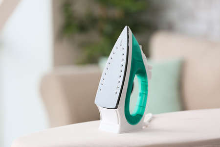 Electric iron on board at home