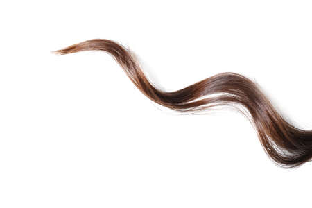 Strand of beautiful curly hair on white background