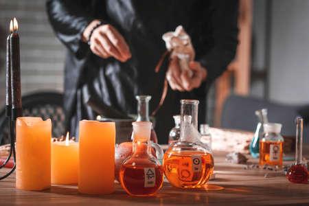 Male alchemist making elixir in laboratory Standard-Bild