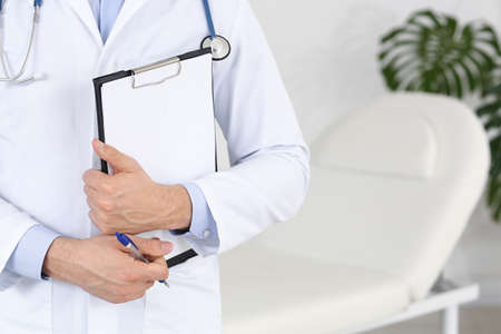 Male doctor in clinic, closeup