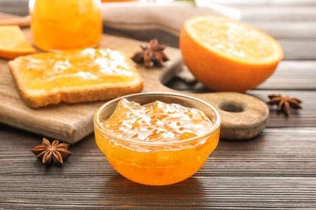 Jar of orange jam on table