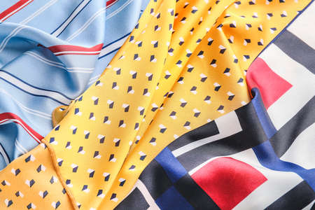 Different beautiful scarves as background Banque d'images