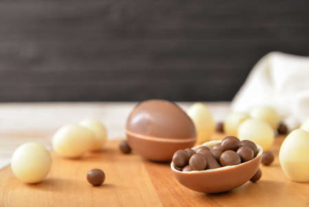 Chocolate eggs and candies on table